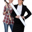 Businesswoman and craftsman posing together — Stock Photo