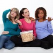 Women disappointed by the end of a movie — Stock Photo #11066215
