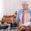 Old woman cooking — Stock Photo #11066356