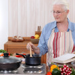 Stock Photo: Old woman cooking