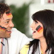 German couple happy with teams performance — Stock Photo