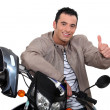 Royalty-Free Stock Photo: Thumbs up from a man with a motorbike
