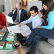 Stock Photo: Architect sat with young family
