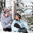 Young couple sat on the snow — Stock Photo