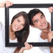 Couple behind black frame — Stock Photo #11068248