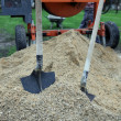 Cement mixer and shovels — Stock Photo