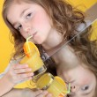 Young girl drinking glass of orange juice — Stock Photo #11068413