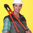 Laborer stood with bolt-cutters - Stock Photo