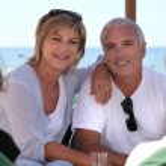 Mature couple sitting on a bar terrace — Stock Photo #11068948