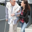 Girl helping older lady — Stock Photo #11069108
