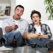 Father and son watching television — Stock Photo