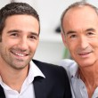 Royalty-Free Stock Photo: Father and son business team