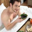 Man having breakfast in bed — Stock Photo #11069692