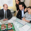 Stock Photo: Architect having meeting with young family