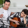 Teenager having music lesson — Stock Photo