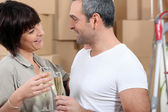 Couple toasting during moving — Stock Photo