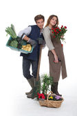 Young florists on white background — Stock Photo