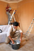 Workers in room under construction — Stock Photo