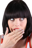 Woman with a bob holding her hand over her mouth — Stockfoto