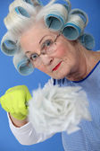 Woman with a feather duster — Stock Photo