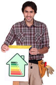 A male carpenter promoting energy savings. — Stock Photo