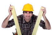 Man between two planks of wood — Stock Photo