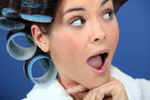 Open-mouthed woman with curlers — Stock Photo