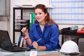 Construction worker ordering parts — Stock Photo