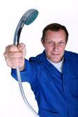 Plumber holding the shower head — Stock Photo