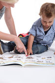 Mother and child looking at a book — Stock Photo