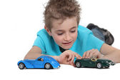 Boy playing with toy cars — Stockfoto