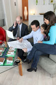 Architect sat with young family — Stock Photo