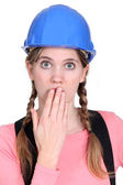 Embarrassed female builder — Stock Photo