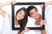 Couple behind black frame — Stock Photo