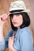 Brunette woman with hat — Stock Photo