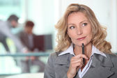 Thoughtful blond woman — Stock Photo