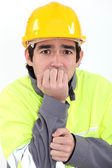 Fearful young worker — Stock Photo