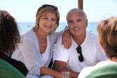 Mature couple sitting on a bar terrace — Stock Photo