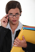 Brilliant female executive holding files — Stock Photo