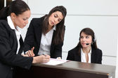 Businesswomen filling in paperwork — Stock Photo