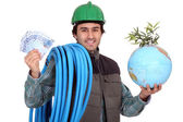 Plumber with cash and a globe — Stock Photo