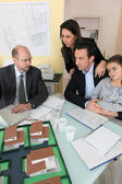 Architect having meeting with young family — Stock Photo