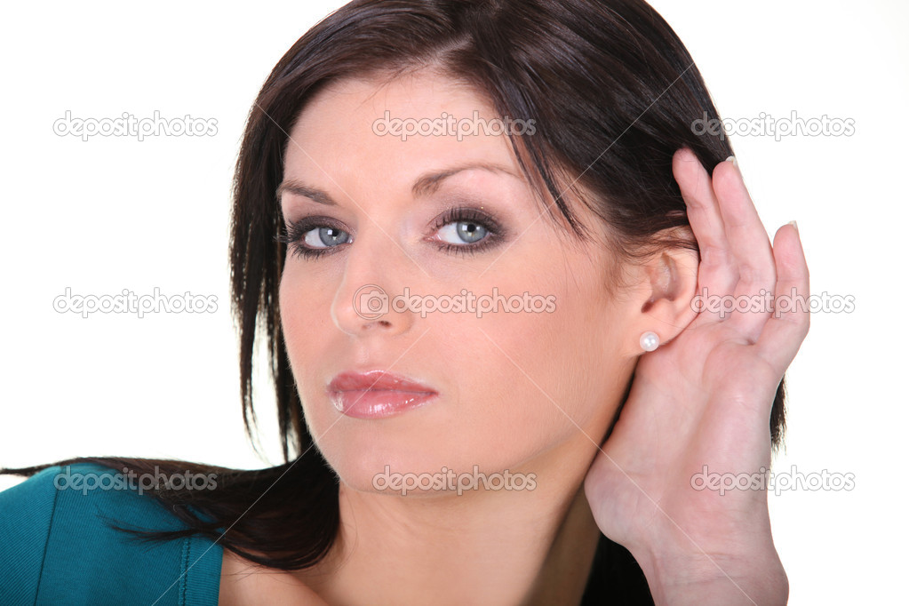 Woman with her hand to her ear — Stock Photo #11061677