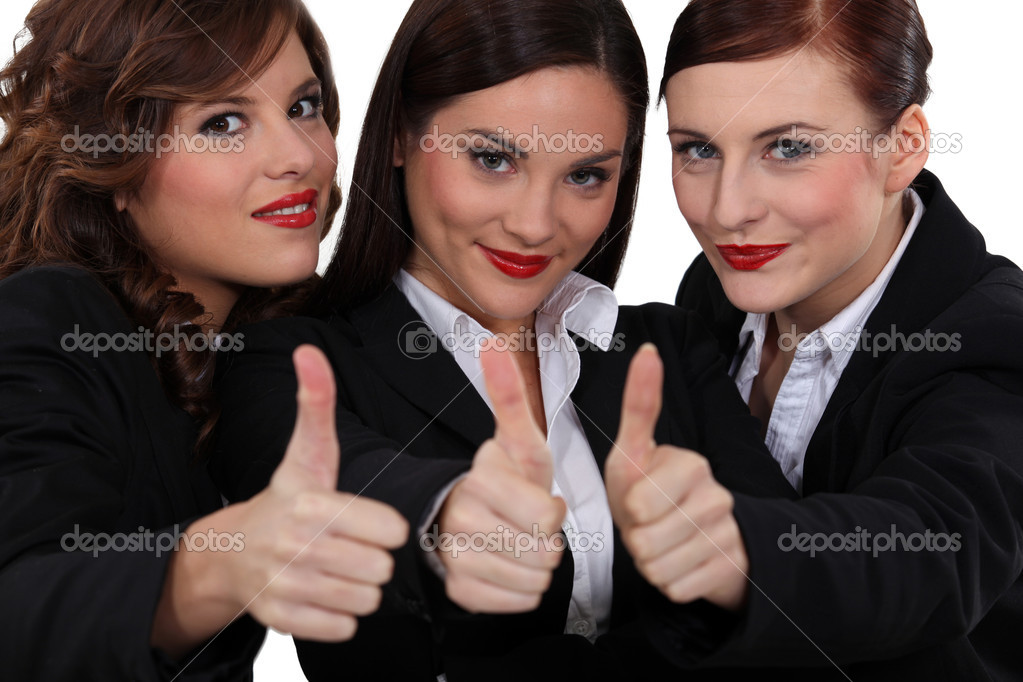 Three businesswomen giving the thumb up. — Stock Photo #11063617