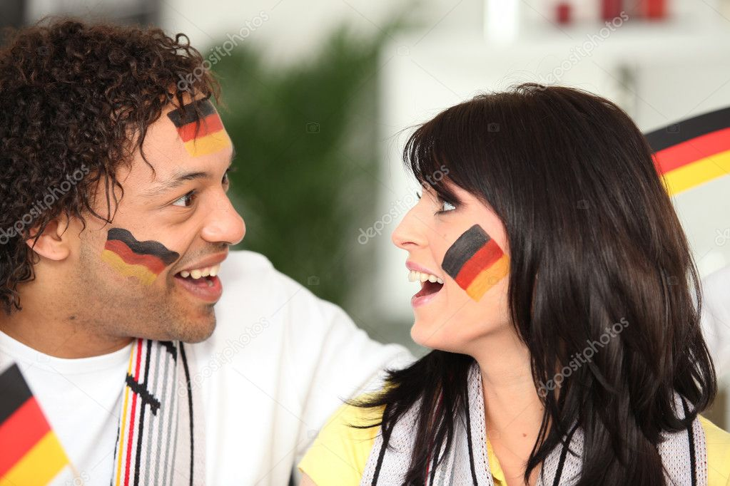 German couple happy with teams performance — Stock Photo #11066382