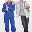 Handyman stood with teenage son — Stock Photo #11070082