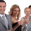 Couples standing holding champagne — Stock Photo