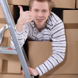 Happy man moving into new flat — Stock Photo