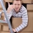 Happy man moving into new flat — Stock Photo