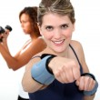 Woman doing exercises with wrist weights — Stok fotoğraf